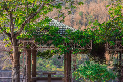 Pavilion. In the flower garden Royalty Free Stock Photo
