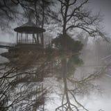 Pavilion at foggy lake Stock Photos