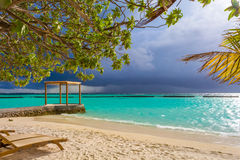 Pavilion in front of storm at Maldives. Pavilion at white sand beach in front of storm at Maldives Stock Images