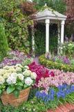Pavilion in garden. Pavilion in beautiful flower garden stock image