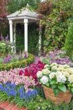 Pavilion in garden. Pavilion in beautiful flower garden stock photo