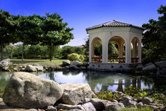 Pavilion in the garden. Day time Stock Images
