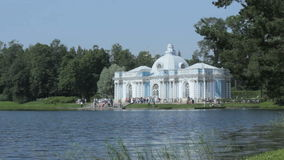 Pavilion `Grotto` on the bank of the Big pond of Catherine Park, Tsarskoye Selo Pushkin, Saint Petersburg. Tsarskoye Selo Pushkin timelapse, Saint Petersburg stock footage