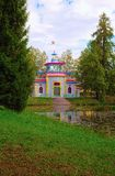 The pavilion known as the Creaking - or Chinese - Summer-House is located on the picturesque bank of a pond in Tsarskoye Selo, Pus Stock Photography