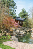 Pavilion in Korean Seoul garden. Gardens of the World. Korean Seoul garden is a symbol of friendship between Berlin and Seoul. Pavilion Water pavilion on a rock Stock Photos