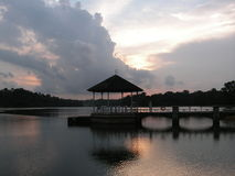 Pavilion on lake at dusk Royalty Free Stock Photos