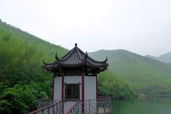 A pavilion at the lake with mountains background Royalty Free Stock Images