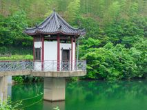 A pavilion at the lake with mountains background Royalty Free Stock Photo