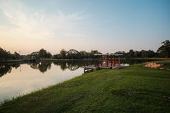 Pavilion lake side. Public park in peaceful having a pavilion at lake side and green grass area Stock Photography