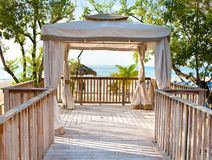 Pavilion in natural style on  beach. Royalty Free Stock Photos