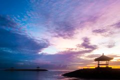 Pavilion Near Calm and Peaceful Beach on Sunrise. Concept of Harmony and Soul Searching. Pavilion Near Calm and Peaceful Beach on Sunrise with Two Other Pavilion royalty free stock photography