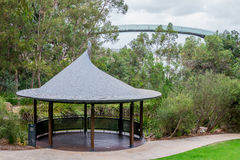 Pavilion near a pond and an observation walking bridge in Kings Royalty Free Stock Image