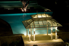 Pavilion near the pool. At night Stock Photos