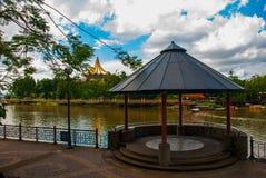 Pavilion near the water with views of the Dewan Undangan Negeri Sarawak. Kuching, Sarawak, Malaysia. Pavilion near the water with views of the Dewan Undangan Stock Photo