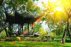 Pavilion of old Chinese style in public park with sun lighting flare effect. Stock Photo