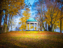 Pavilion in a park. With trees and autumn leaves royalty free stock photos