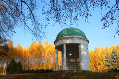 Pavilion in a park with yellow birch trees Royalty Free Stock Photo