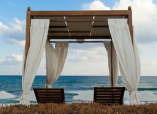 Pavilion for relax on the beach in resort. Early morning Royalty Free Stock Photo