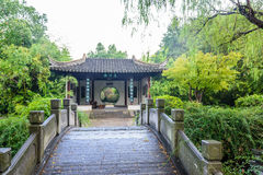 Pavilion and stone arch bridge. After the rain .This photo was taken in Nanjing China Green Expo Garden ,Nanjing city, Jiangsu province, china Stock Image