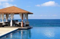 Pavilion and swimming pool near Atlantic Ocean Stock Images