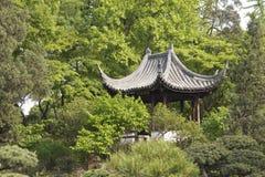 Pavilion between trees Stock Photo