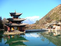 Pavilion under Yulong Snow Mountain in Yunnan Province, China royalty free stock images