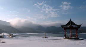 Pavilion in the winter. The pavilion aroud the lake in the snow is very charming stock photos