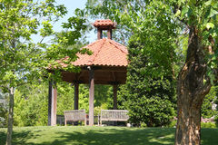 Pavilion with wood chairs in spring park. Picture about a pavilion with wood chairs in Dallas Arboretum, TX Stock Photography