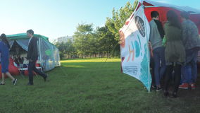 Pavilions social groups at festival stock video