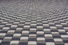 Pavimentação de pedra moderna dos quadrados brancos e cinzentos Imagem de Stock