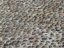 Pavimentación de los guijarros de la textura de los guijarros que pavimentan Fotos de archivo libres de regalías