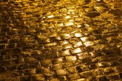 Pavimentación de oro Imagen de archivo libre de regalías