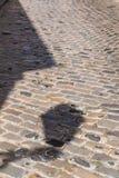 Pavimentando con un'ombra di una lanterna Fotografia Stock