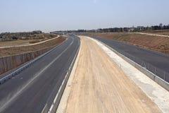 Pavimentando uma estrada nova Fotografia de Stock Royalty Free