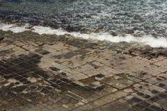 Pavimentazione decorata con mosaico a scacchiera al collo di Eaglehawk, Tasmania Fotografie Stock