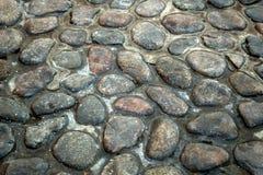 Pavimentazione del ciottolo, pietre per lastricati di pietra immagini stock