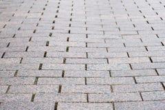 Pavimentazione del granito di vecchia parte della città Fondo, struttura immagini stock