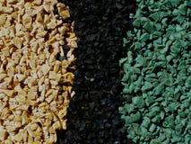 Pavimentazione di gomma granulata di sport della particella fine nei colori e nelle forme astratti fotografia stock libera da diritti