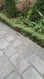 Pavimentazione di pietra del blocco quadrato Immagine Stock