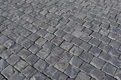 Pavimentazione di pietra grigia del fondo del ciottolo Fotografie Stock Libere da Diritti
