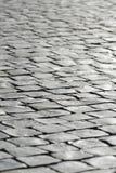 Pavimentazione di pietra grigia del fondo del ciottolo Fotografia Stock Libera da Diritti