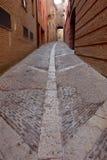 pavimentazione di una via lunga Immagini Stock