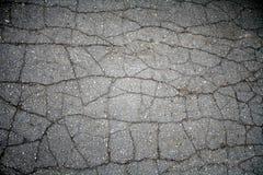 Pavimentazione incrinata dell'asfalto Immagini Stock Libere da Diritti