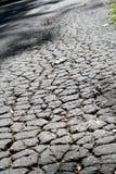 Pavimentazione incrinata dell'asfalto Immagine Stock Libera da Diritti