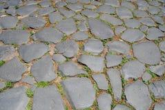 Pavimentazione intorno al Colosseum. Roma fotografia stock libera da diritti