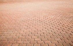 Pavimentazione rossa moderna del ciottolo, fondo Fotografia Stock Libera da Diritti