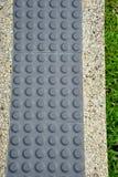 Pavimentazione tattile per l'handicap cieco fotografia stock