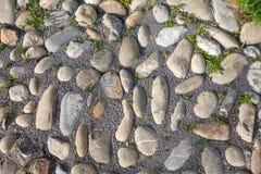 Pavimento áspero das pedras do rio Fotografia de Stock