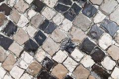 Pavimento de camino de piedra viejo, fondo Imagen de archivo