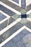 Pavimento del extracto de la calle del arsizio de Busto de una iglesia ymarble Imagen de archivo libre de regalías